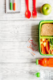 Kid menu lunchbox for school top view on wooden background Royalty Free Stock Photography