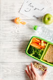 Kid menu lunchbox for school top view on wooden background Royalty Free Stock Photo