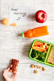 Kid menu lunchbox for school top view on wooden background Stock Photos