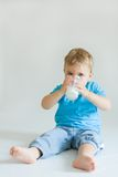 Kid and milk Stock Photography
