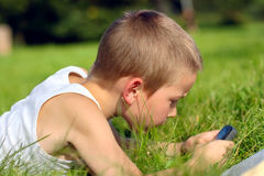 Kid with mobile phone Royalty Free Stock Images