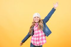 Kid model in jeans jacket, hat smile and pose. Kid model with long blond hair in jeans jacket, hat, plaid shirt smile and pose on orange background. Happy child Stock Photos