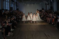 Kid models walk the runway for the Berta Bridal Spring 2019  Fashion show. NEW YORK, NY - APRIL 13: Kid models walk the runway for the Berta Bridal Spring 2019 Royalty Free Stock Images