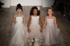 Kid models walk the runway for Blush by Hayley Paige  Bridal show Fall/Winter 2018 Collection. NEW YORK - OCTOBER 6: Kid models walk the runway for Blush by Stock Images