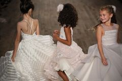 Kid models walk the runway for Blush by Hayley Paige  Bridal show Fall/Winter 2018 Collection. NEW YORK - OCTOBER 6: Kid models walk the runway for Blush by Stock Image