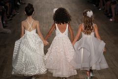 Kid models walk the runway for Blush by Hayley Paige Bridal show Fall/Winter 2018 Collection. NEW YORK - OCTOBER 6: Kid models walk the runway for Blush by Royalty Free Stock Photo
