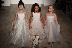Kid models walk the runway for Blush by Hayley Paige  Bridal show Fall/Winter 2018 Collection. NEW YORK - OCTOBER 6: Kid models walk the runway for Blush by Royalty Free Stock Photos