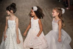 Kid models walk the runway for Blush by Hayley Paige  Bridal show Fall/Winter 2018 Collection. NEW YORK - OCTOBER 6: Kid models walk the runway for Blush by Stock Photo