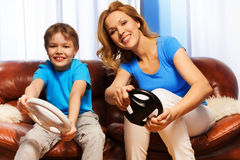 Kid and mom driving steering wheels Stock Photography