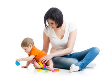 Kid and mom play together with cup toys Stock Images