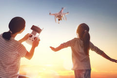 Kid and mom playing with drone Stock Photography