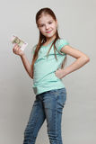 Kid and money Royalty Free Stock Images