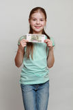 Kid and money Stock Photography