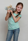 Kid and money Stock Images