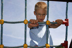 Kid on monkey bars Royalty Free Stock Photography