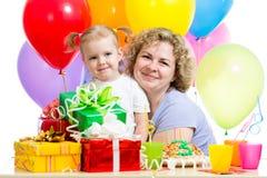 Kid and mother celebrate birthday Stock Photos