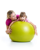 Kid and mother with fitness ball. Kid girl and mother with fitness ball Stock Photo