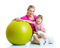 Kid and mother with fitness ball. Kid girl and mother with fitness ball Royalty Free Stock Photo