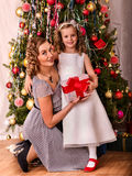 Kid with mother greeted Christmas Stock Photo