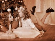 Kid with mother near Christmas tree. Stock Photography