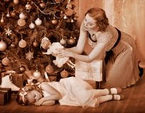 Kid with mother near Christmas tree. Stock Image