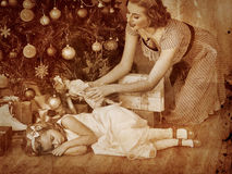 Kid with mother near Christmas tree. Royalty Free Stock Images
