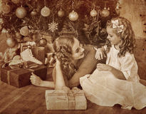 Kid with mother near Christmas tree. Stock Photo