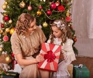 Kid with mother near Christmas tree. Stock Photos