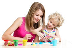 Kid and mother play clay toy Stock Image