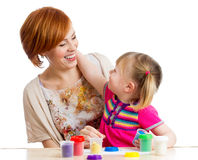 Kid and mother play clay toy Royalty Free Stock Photos