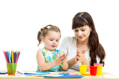 Kid and mother play color clay toy Royalty Free Stock Image