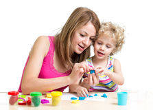 Kid and mother play colorful clay toy Royalty Free Stock Images