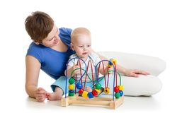 Kid and mother play with educational toy Stock Photos