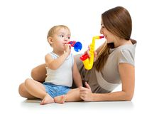 Kid and mother play musical toys Stock Photos