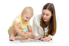 Kid and mother play together with puzzle toy Stock Photography