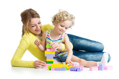 Kid and mother play toys Stock Photos