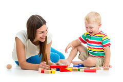 Kid and mother play toys together Stock Photo