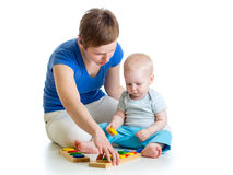Kid and mother playing together with puzzle toy Stock Images