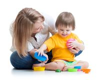 Kid and mother playing with toys Royalty Free Stock Photos