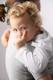 Kid on mothers hands. Stock Images