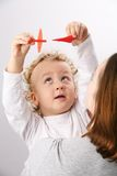 Kid on mothers hands. Royalty Free Stock Images