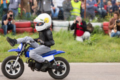 Kid on motorcycle stunt shows Royalty Free Stock Photography
