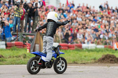 Kid on motorcycle stunt shows Royalty Free Stock Photos