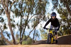 Kid mountain biking royalty free stock photo