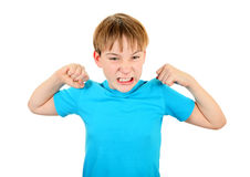 Kid Muscle flexing. Angry Kid Muscle Flexing Isolated on the White Background Stock Photography