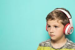 Child with music headphones stock images