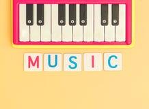 Kid Music toy keyboard on orange background. Kid Music With toy keyboard on orange background royalty free stock photography