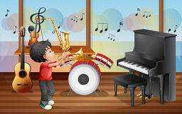 A kid with musical instruments Stock Photos