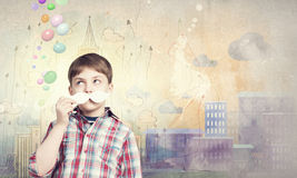 Kid with mustache Stock Photos