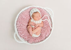 Kid napping on big pink pillow Stock Photography